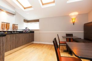 A kitchen or kitchenette at The Abbey Lodge Hotel