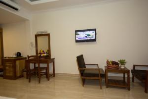 A television and/or entertainment center at Dinata Angkor Boutique Hotel
