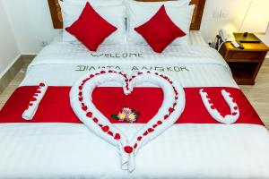 A bed or beds in a room at Dinata Angkor Boutique Hotel