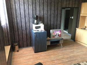A television and/or entertainment center at Europe Dunav Apartment