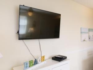 A television and/or entertainment center at The Sea Spray Resort