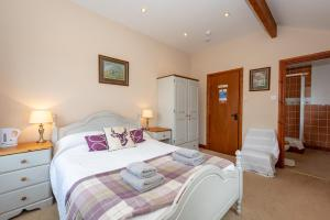 A bed or beds in a room at White Hart Inn
