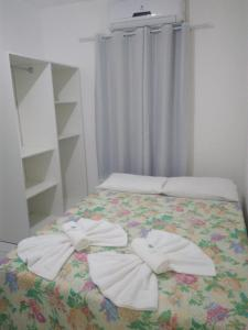 A bed or beds in a room at Pousada Beira Mar