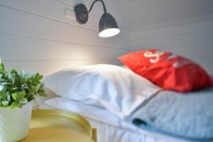 Łóżko lub łóżka w pokoju w obiekcie Bla Marine Domki nad Morzem