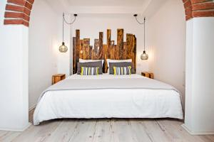 A bed or beds in a room at Casa Mulino