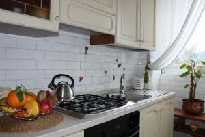 Una cocina o zona de cocina en Como Happy Days