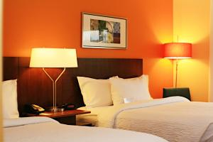 A bed or beds in a room at Best Western LSU/Medical Corridor Inn & Suites