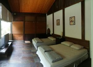 A bed or beds in a room at Bright Moon Homestay