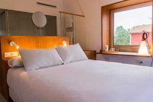 Cama o camas de una habitación en Hotel Bela Fisterra