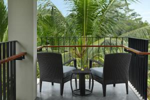 A balcony or terrace at Royal Kamuela Villas & Suites at Monkey Forest Ubud
