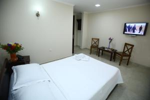 A bed or beds in a room at Rose Hotel
