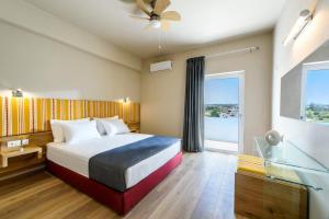 Ένα ή περισσότερα κρεβάτια σε δωμάτιο στο Aptera Beach