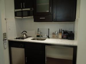 A kitchen or kitchenette at East Village Hotel