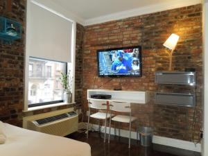 A television and/or entertainment center at East Village Hotel
