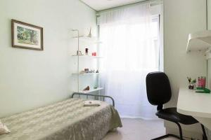 A bed or beds in a room at Apto 5 Quartos Avenida Carlos Gomes