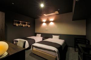 A bed or beds in a room at Wakayama Urban Hotel