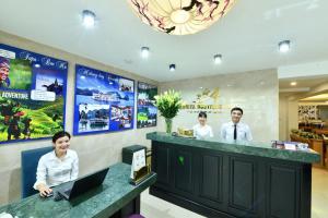 Members of staff at Amorita Boutique Hotel Hanoi