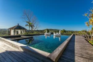 The swimming pool at or near A PERFECT STAY - Aria - Holiday House