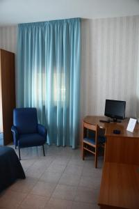 A television and/or entertainment center at Hotel Pineta