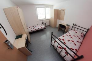 Postelja oz. postelje v sobi nastanitve Hostel Velenje