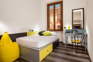 A bed or beds in a room at Free Hostels Roma