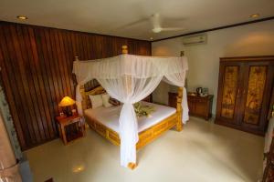 Ein Bett oder Betten in einem Zimmer der Unterkunft Hotel Shri Ganesh