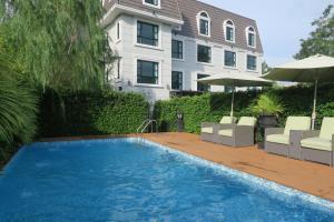 Der Swimmingpool an oder in der Nähe von Marquise Boutique Hotel