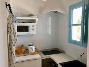 A kitchen or kitchenette at Apartment Meridium