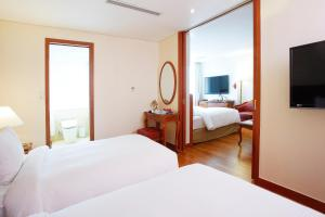 A bed or beds in a room at Sejong Hotel Seoul Myeongdong