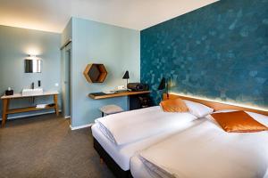 Ein Bett oder Betten in einem Zimmer der Unterkunft Hotel Restaurant Stern Luzern