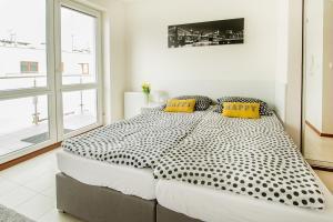 Łóżko lub łóżka w pokoju w obiekcie Apartament Kniaziewicza - Komfortowe Noclegi