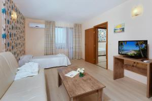 A television and/or entertainment center at Relax Holiday Complex & Spa