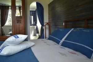 A bed or beds in a room at L'Araucaria