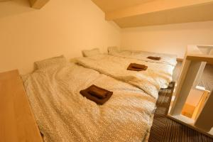 A bed or beds in a room at Shibuya - house / Vacation STAY 634