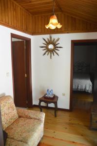 Uma área de estar em Casa Do Carvalho