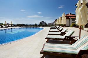 The swimming pool at or near Relax Holiday Complex & Spa