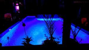 Изглед към басейн в Семеен Хотел Лудо или наблизо