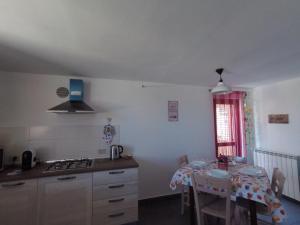 A kitchen or kitchenette at Kalshouse Rizzo