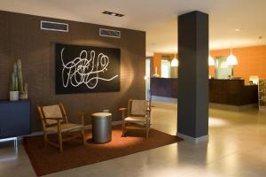 The lobby or reception area at Magnolia Hotel - Adults Only