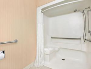 A bathroom at Ramada by Wyndham Greensburg Hotel & Conference Center
