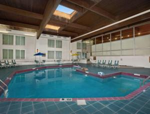 The swimming pool at or near Ramada by Wyndham Greensburg Hotel & Conference Center