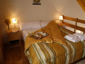 A bed or beds in a room at Esquel Apart