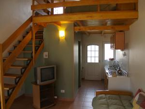 A television and/or entertainment center at Esquel Apart