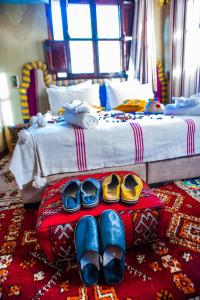 A bed or beds in a room at Toubkal Ecolodge
