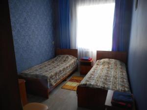 Кровать или кровати в номере Hotel Traktir Yamschik