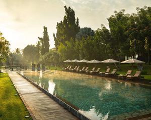 The swimming pool at or near Tanah Gajah, a Resort by Hadiprana