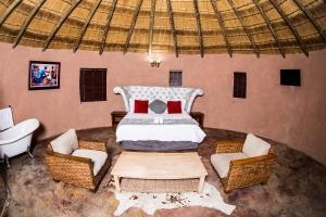 A bed or beds in a room at Dzata Private Game Lodge