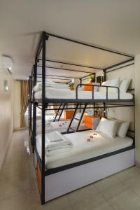A bunk bed or bunk beds in a room at Cannon Fort Cat Ba Hotel