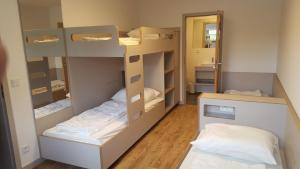 A bunk bed or bunk beds in a room at Jugendherberge-Berlin-International
