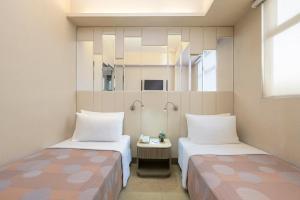 Кровать или кровати в номере Silka Seaview Hotel